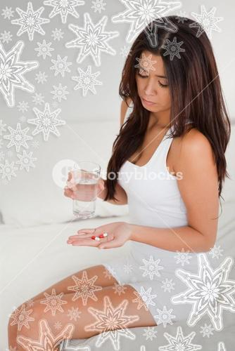 Darkhaired woman having stomach ache taking pills