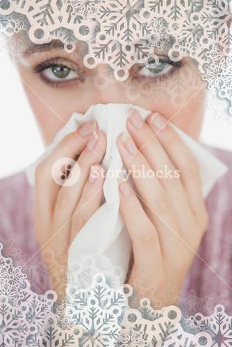 Unhappy young woman suffering from cold