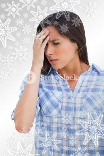 Woman with a headache and hand on forehead