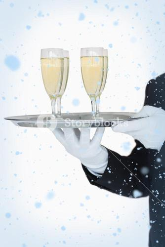 Waiter holding tray of champagne flutes