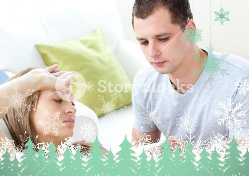 Caring man check the temperature of his sick girlfriend with a thermometer
