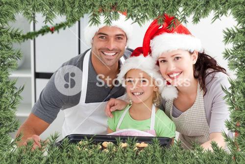 Happy woman with husband and daughter with their biscuits ready