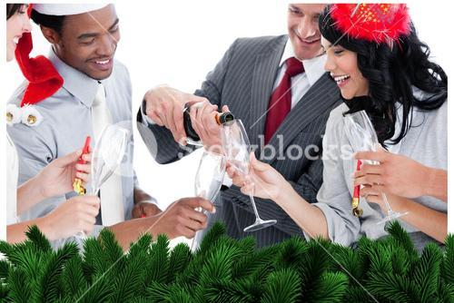 Business team drinking champagne to celebrate christmas