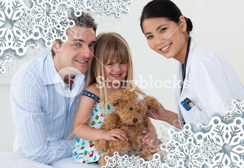 Portrait of a doctor and happy little girl examing a teddy bear