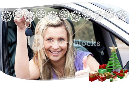 Charming female driver showing a key after bying a new car