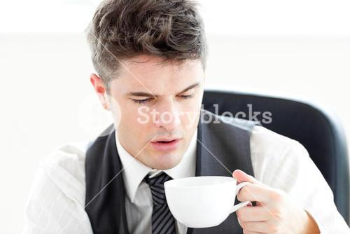 Tired businessman drinking coffee