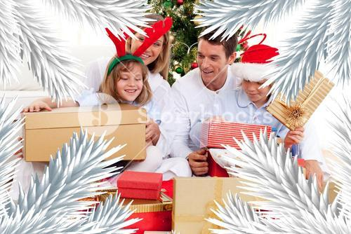 Young family having fun with christmas gifts