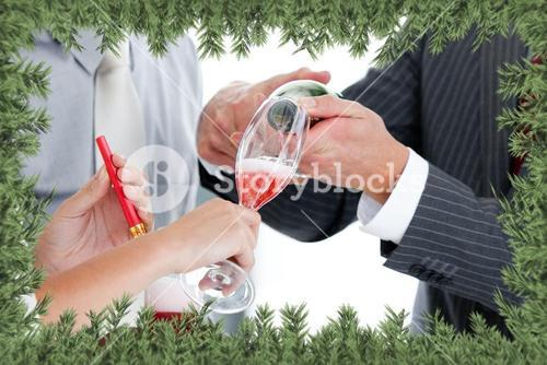 Close up of two colleague drinking champagne to celebrate christmas