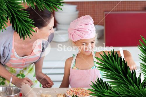 Cheerful mother and her daughter baking in a kitchen
