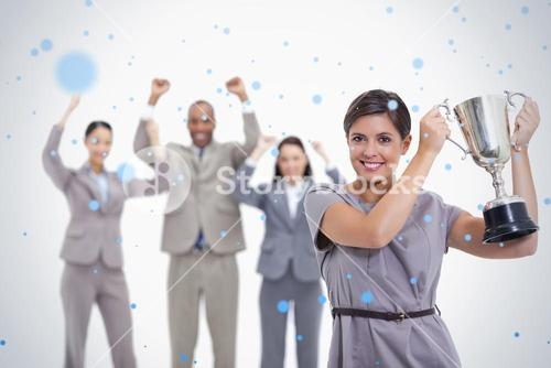 Woman holding up a cup with enthusiastic coworkers