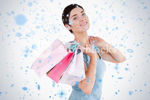 Darkhaired woman posing with shopping bags