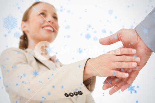 Low angleshot of a woman shaking hands