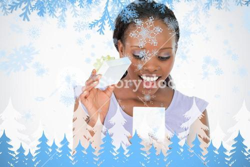 Close up of woman being happy about what is in her present against a white backgr