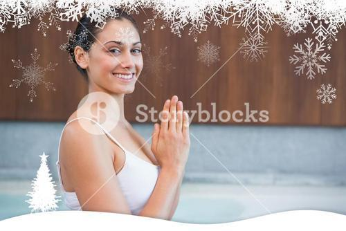 Content brunette in white sitting in lotus pose