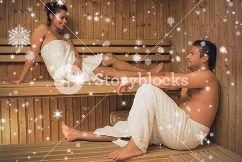 Happy couple relaxing in a sauna and chatting