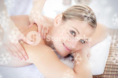 Smiling woman receiving a back massage