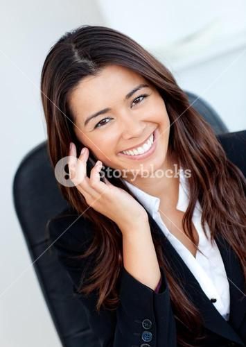 Jolly businesswoman talking on phone