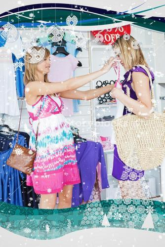 Cheerful women choosing clothes together