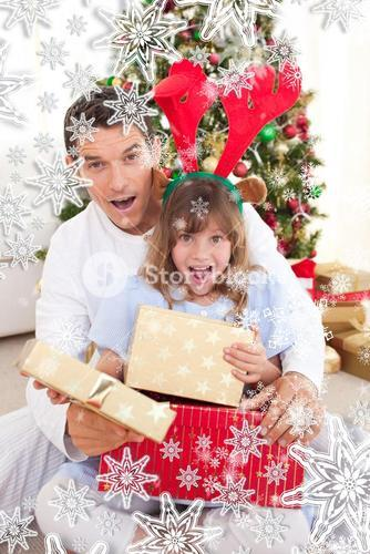 Surprised father and his girl opening christmas gifts