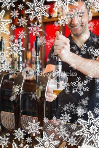 Composite image of handsome barkeeper pulling a pint of beer