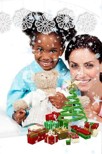 Composite image of smiling little girl with her nurse looking at the camera