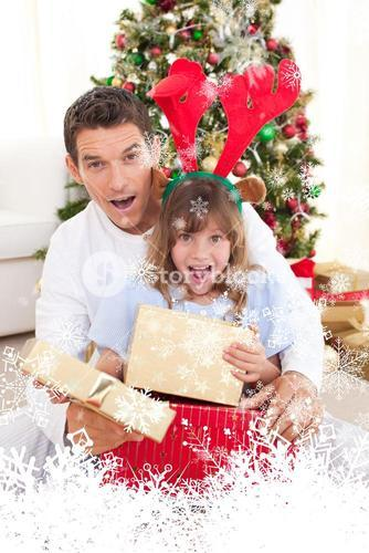 Composite image of surprised father and his girl opening christmas gifts