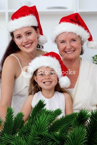 Daughter mother and grandmother baking christmas sweets