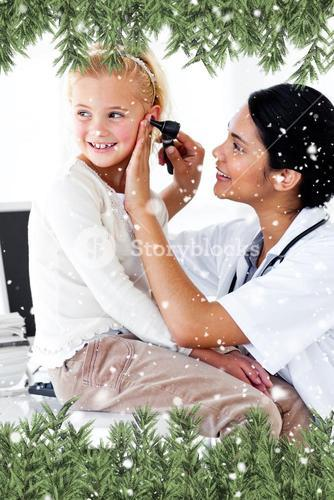 Composite image of cute little girl attending a medical checkup