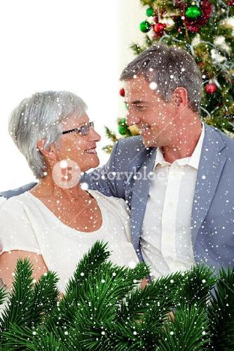 Composite image of senior couple in love in christmas