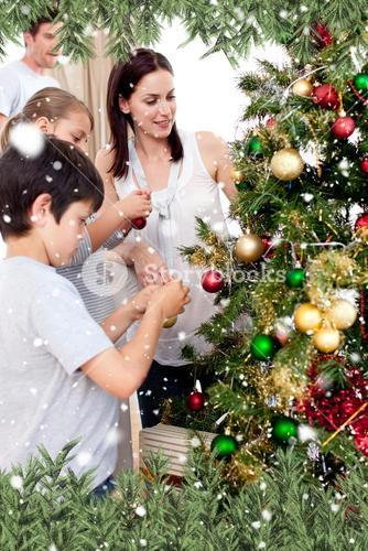Composite image of happy children and parents decorating a christmas tree