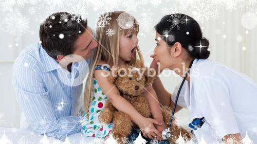 Composite image of doctor examining childs throat