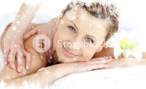 Composite image of delighted woman enjoying a back massage