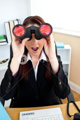 Astonished businesswoman looking through spyglasses