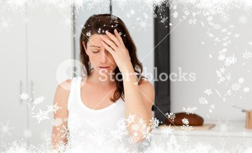 Composite image of exhausted woman having a headache in her bathroom