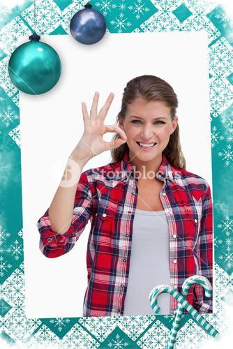 Composite image of portrait of a woman signing that everything is fine