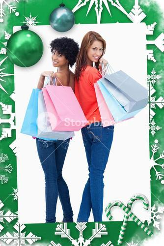 Composite image of smiling teenagers looking behind them after shopping