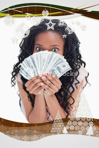 Woman is holding american dollars up to her face