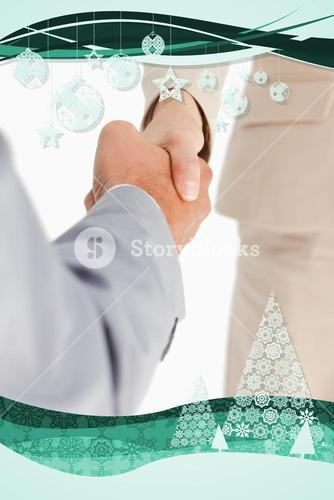 Composite image of business people are shaking hands