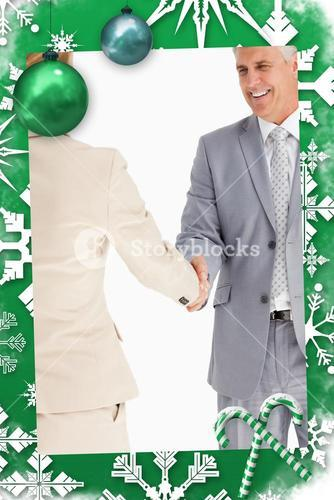 Composite image of happy business people shaking hands