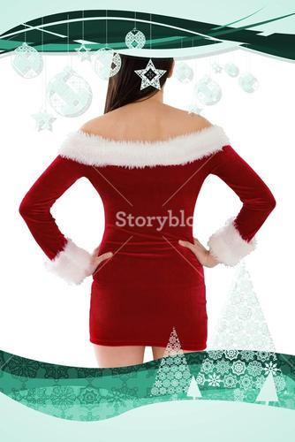 Composite image of santa girl standing with hands on hips