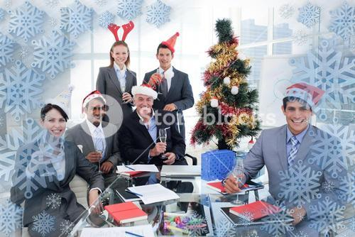 Composite image of portrait of a happy business team toasting with champagne at a christmas party