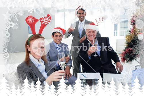 Composite image of business team toasting with champagne at a christmas party
