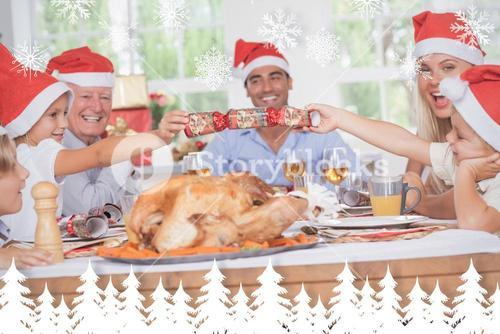 Composite image of siblings pulling a christmas cracker