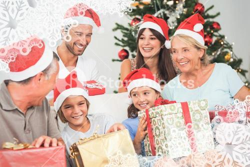 Composite image of happy family at christmas swapping gifts