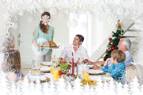 Composite image of mother serving christmas meal to family