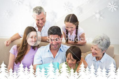 Composite image of man opening birthday present at home
