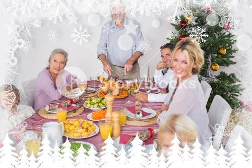 Composite image of happy family at christmas dinner