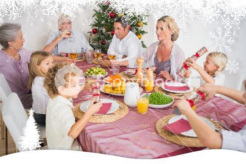Composite image of family having christmas dinner