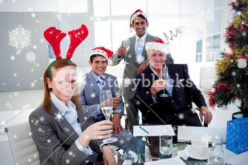 Business team toasting with champagne at a christmas party