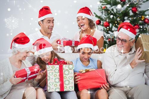 Composite image of excited family exchanging gifts at christmas